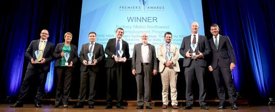 Workforce International's Vic Arciuli (second from right) with the award-winning team and the NSW Premier